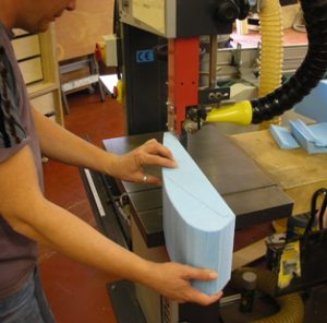 Alex Petts cutting blue foam on the bandsaw.