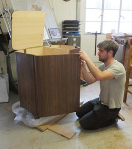Darren fitting hinges on curved cabinet doors.