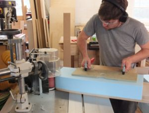 Darren Hancock on the spindle moulder making a former from blue foam.