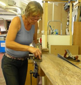 Jo Finch hand planing rippled walnut.