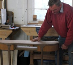Martin Jelinek clamping up a traditional hall table.