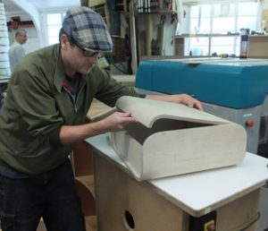 John Lilley fitting a curved lid on his curved box.