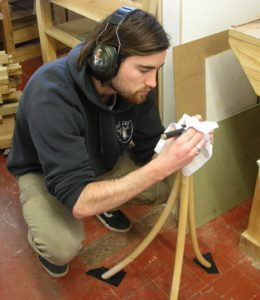 Luke Olney putting finishing touches to his guitar stand.