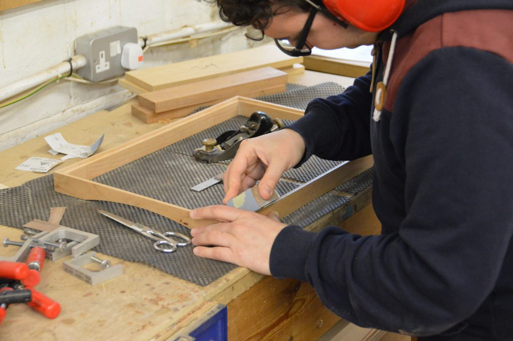 One week student working on his tray project