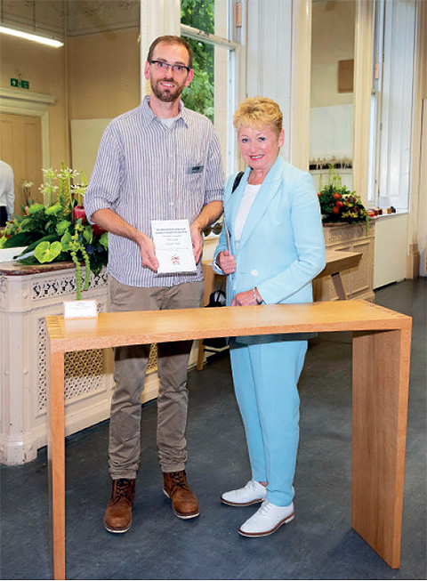 Theo receiving the award for his console table from Dids McDonald, OBE